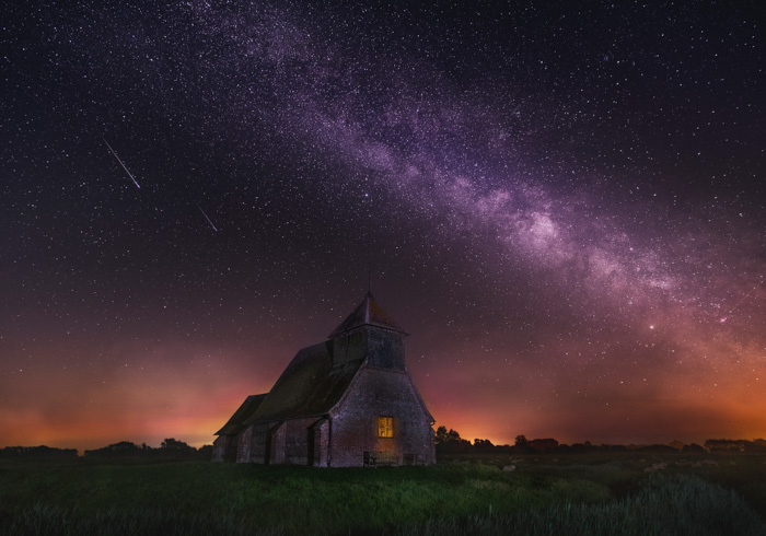 Stunning shot of a star filled sky over a stone church
