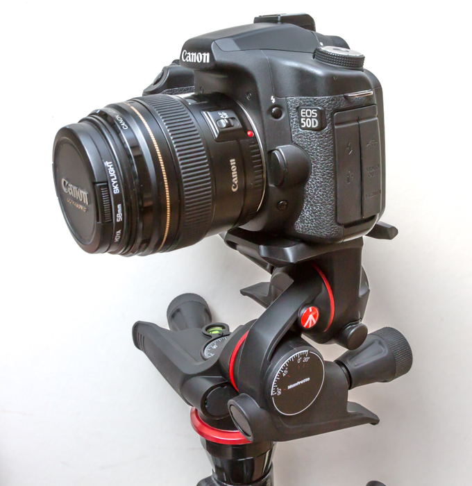 A DSLR camera mounted on a gearded hear for shooting time-lapse photography subjects