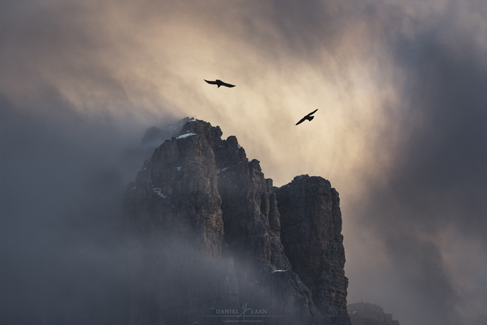 A breathtaking mountain photography shot in dark cloudy weather