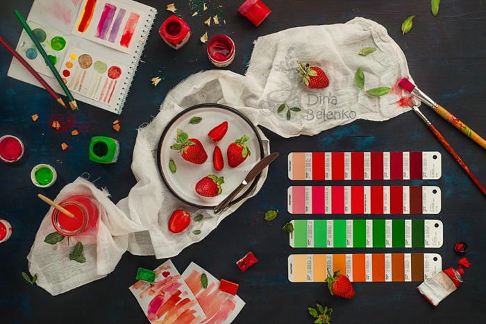 A fun flat lay still life with emphasis on contrasting colors red and green