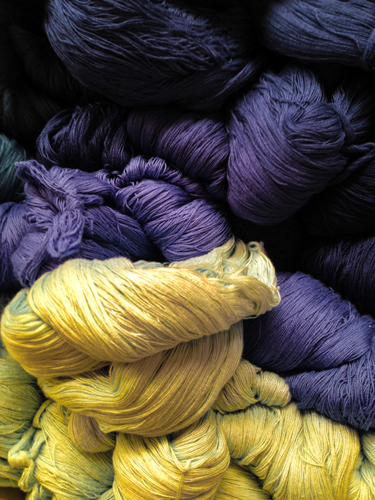 Yellow and purple wool unarranged - complementary colors.