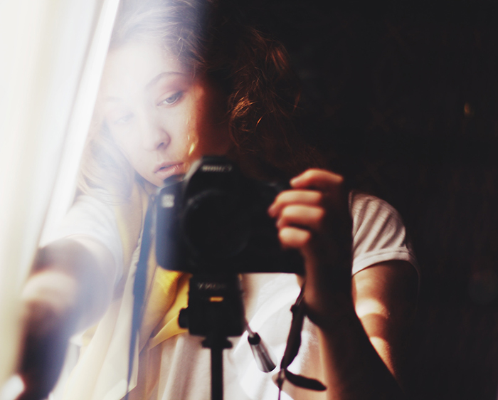 dreamy self portrait of a female photographer