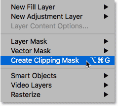 Choosing the Create Clipping Mask command in Photoshop.