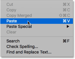 Choosing the Paste command from under the Edit menu in Photoshop.